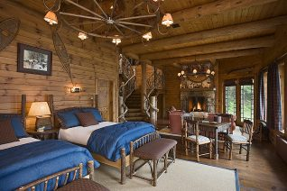 Interior, horizontal, lower level of Honeymoon cabin toward fireplace, Camp Topridge, Paul Smiths, New York, Maple Island Log Homes