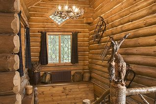 Interior, vertical, birch stairway in Honeymoon Cabin, Camp Topridge, Paul Smiths, New York, Maple Island Log Homes