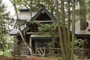 Exterior, horizontal, South Guest Cabin with trees growing through roof, Camp Topridge, Paul Smiths, New York, Maple Island Log Homes